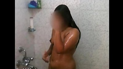 Indian wife taking shower after sex with her man soaping her boobs and pussy